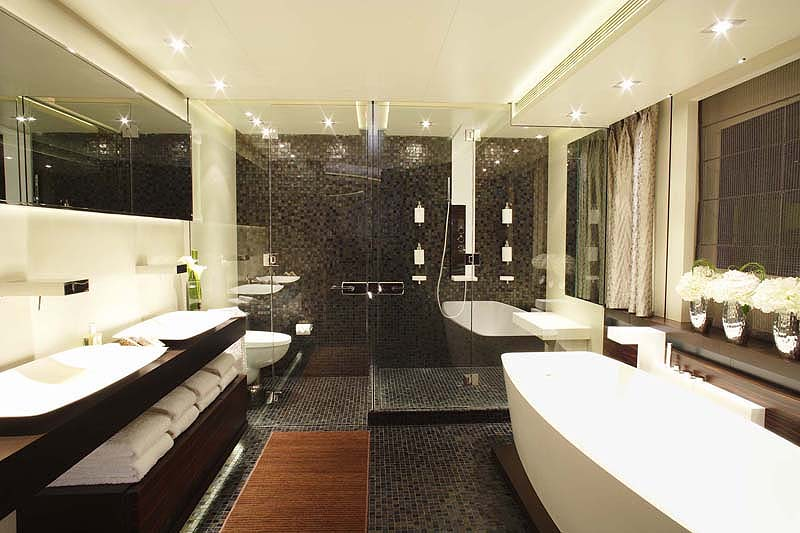 Here The Huge Shower Refracting Through Clear Glass Against Walls Of Tile Presents An Artistic Array Modern Design