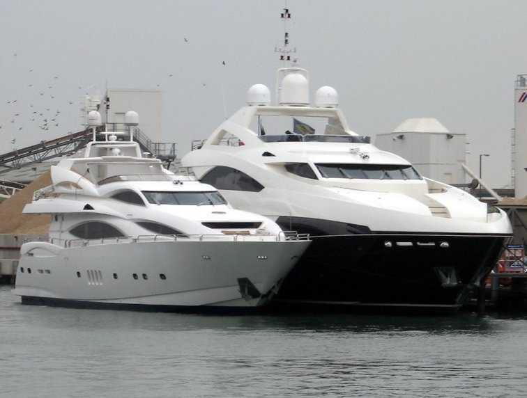 The 105 Yacht alongside the 37M Yacht. Attached Images