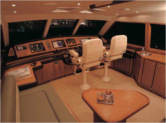 This is from the Bertram 670e and it features a settee just aft of the helm.