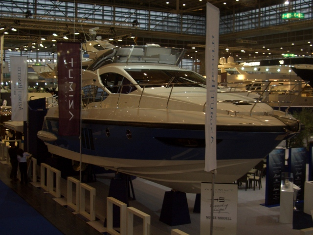 -Atlantis 38. Really cool blue hull clour. Attached Images