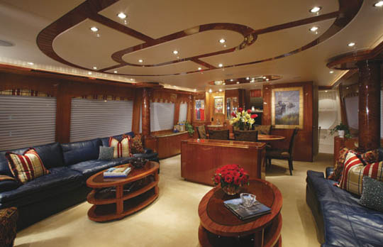 ... twin club chairs, twin end tables and coffee tables. Overhead is a designed headliner, defined to separate sections of the room, while the large windows ...